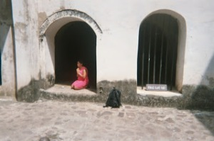 Ananda praying in the African female slave cell at Elmina Slave Castle in Cape Coast, Ghana in 2003